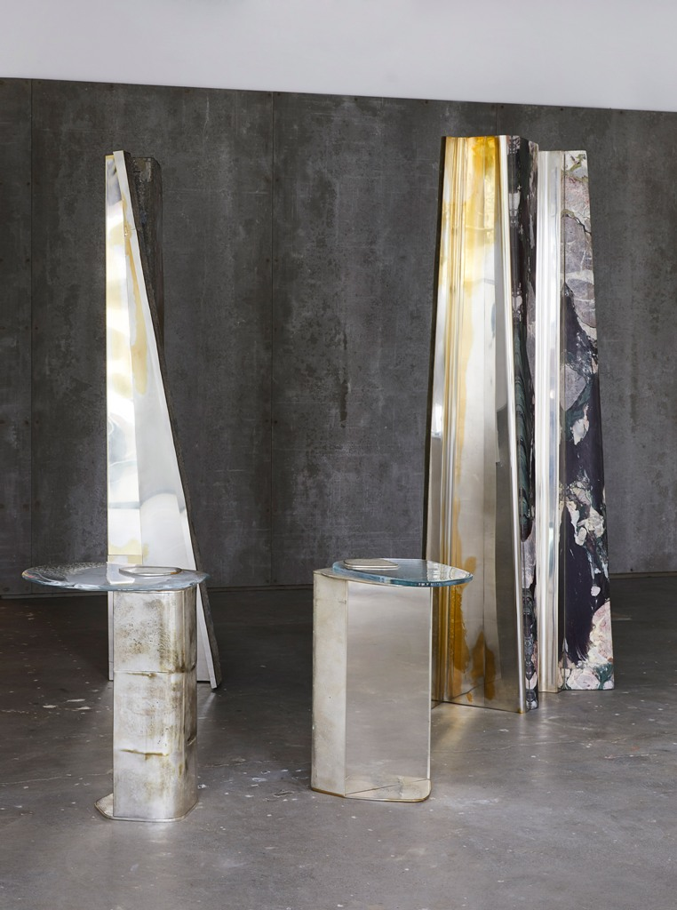 The coffee tabble tops look like molten glass,and the bases are made of metal
