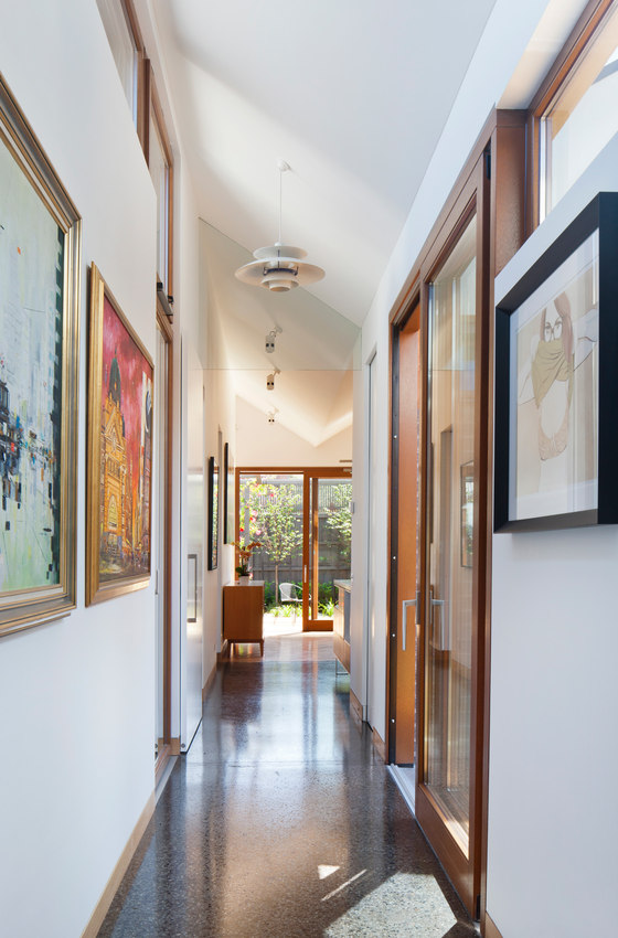The owners wanted their artwork collection to be displayed, and they were hung in the corridors