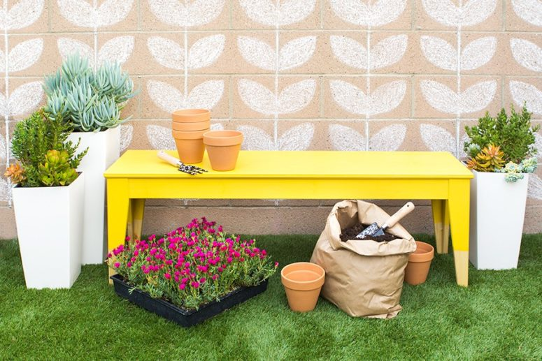 a colorful outdoor bench can be made of an IKEA Nornas bench and some bold paint of your choice