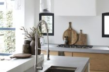 04 a serene contemporary space with light-colored wooden cabinets, upper white ones and concrete countertops