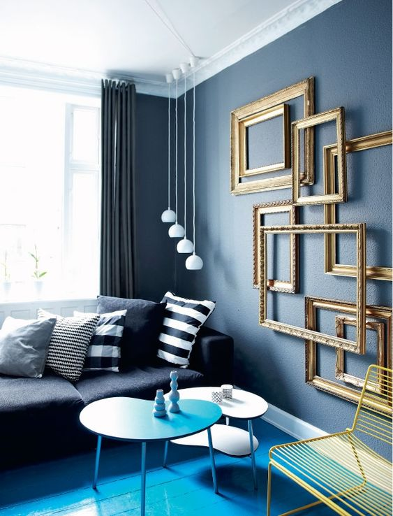 add a refined feel to your living room easily hanging a group of empty frames
