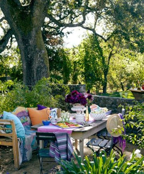 add bright textiles like pillows, blankets, table runners and napkins and a bright floral centerpiece