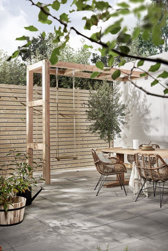 make a light-colored wood plank fence with little space in between the planks for more privacy