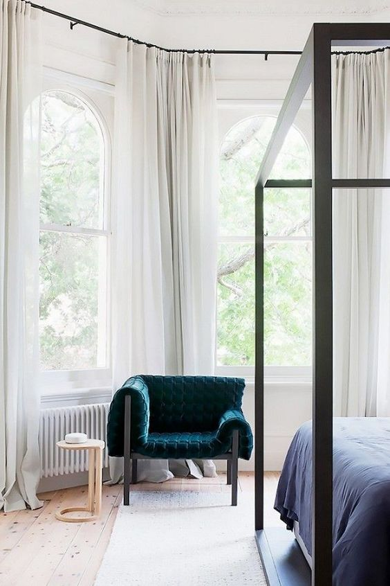 put just one bold chair in the neutral bedroom and it'll be a bright statement