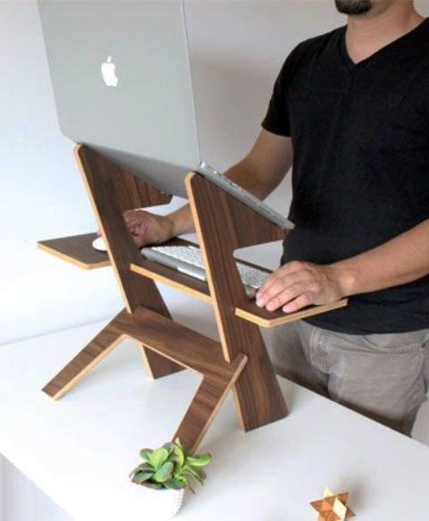 such a simple and chic walnut stand can be used in any space and you may take it with you