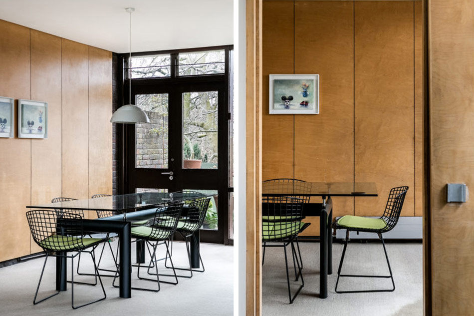 Further you will see a cool dining zone with a black metal table with a glass top and green chairs