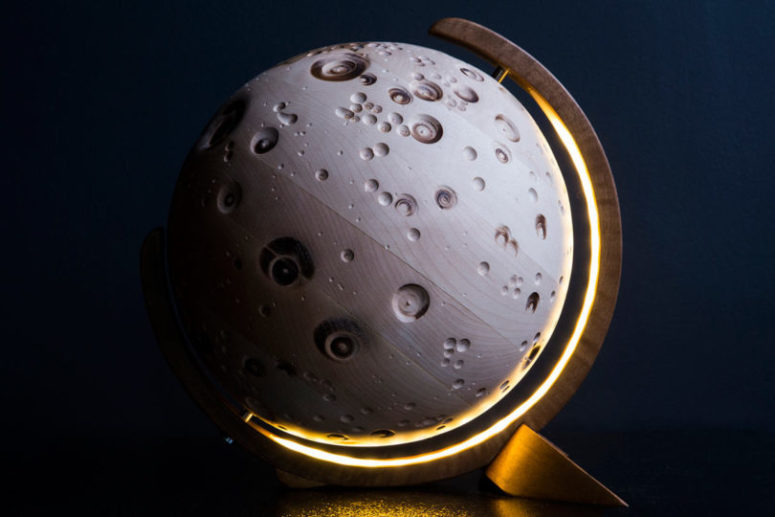 The Moon globe is carved of solid sycamore and resmebles a moon surface