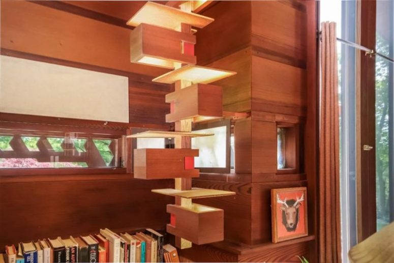 The design of the house contains signature Wright's elements in eahc point including these lit up shelves