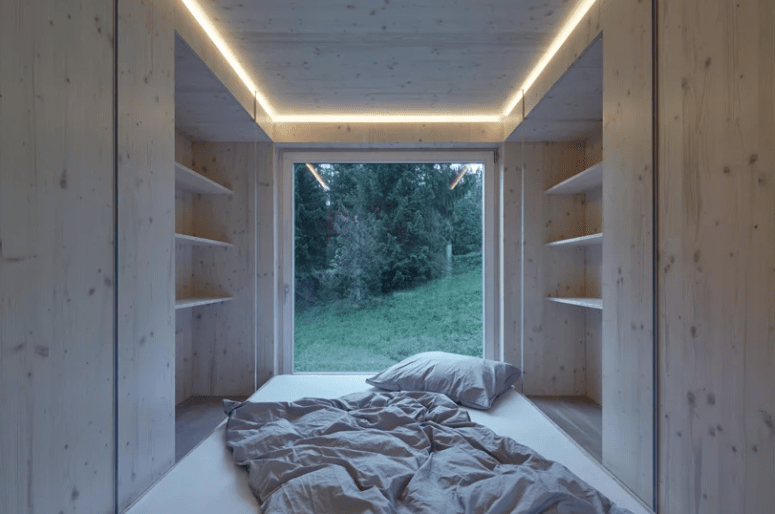There's a sleeping space combined with an open closet, and of course an opening to enjoy the views