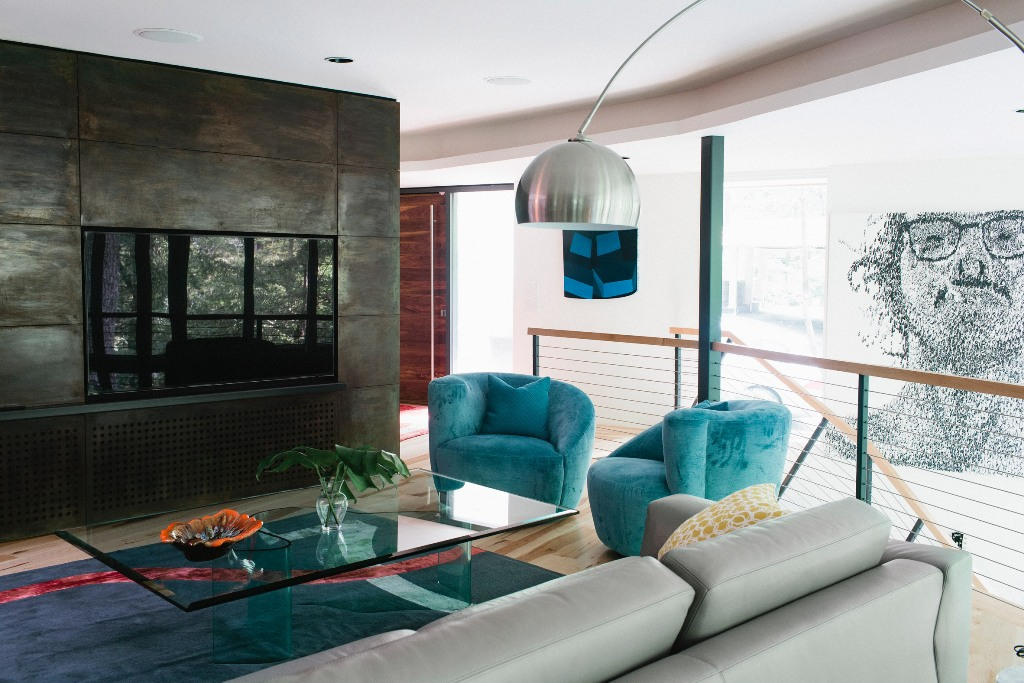 You may see some colorful furniture and a gorgeous metal clad built in fireplace for coziness