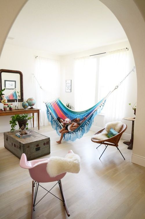 a colorful hammock hung in an alcove is a fun and bright touch to any neutral space