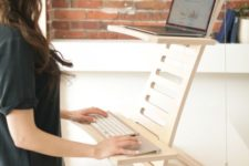 05 a simple and minimalist wooden stand desk is a cool and mobile piece to use at home and in any other space