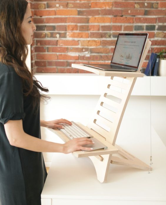 a simple and minimalist wooden stand desk is a cool and mobile piece to use at home and in any other space