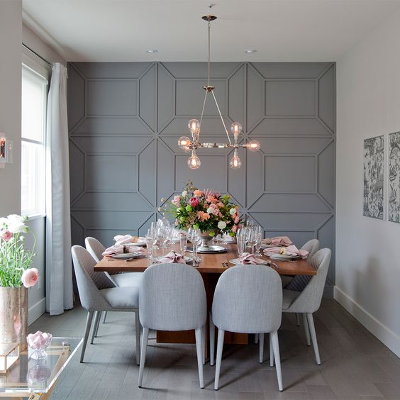 grey geometric panels spruce up the neutral space and make it more eye catching