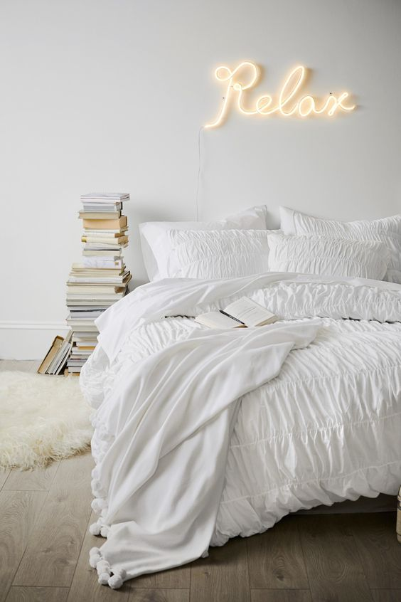 place a neon light over the bed to accent it and make the space stand out, such a calligraphy light is a great idea