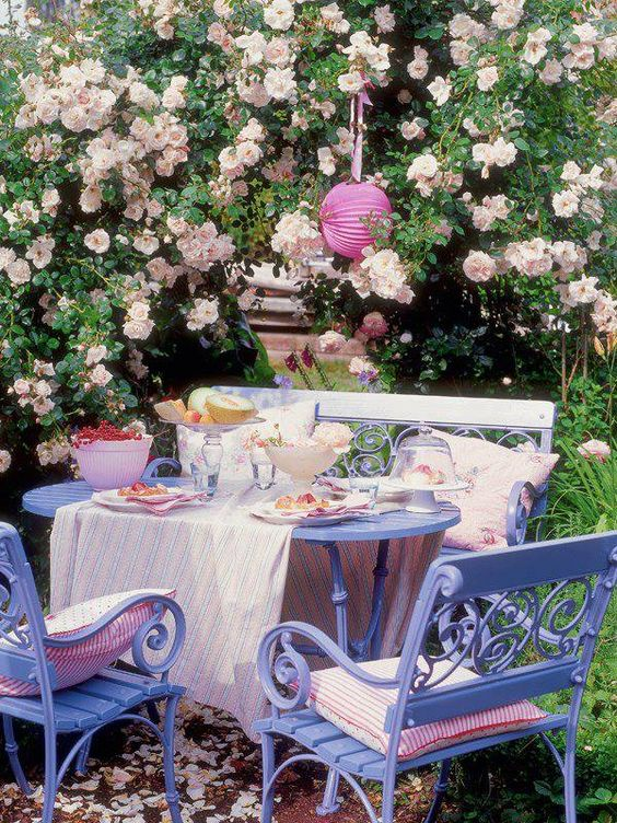 the dining set painted lilac and pink textiles for a welcoming and sweet dining space