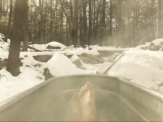 A hot tub is also present to feel full relaxation in a snowy forest