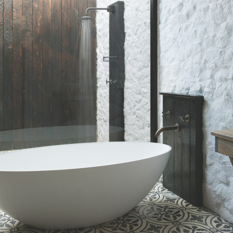There's a bathtub and a shower that feels almost like outdoors thanks to the skylight