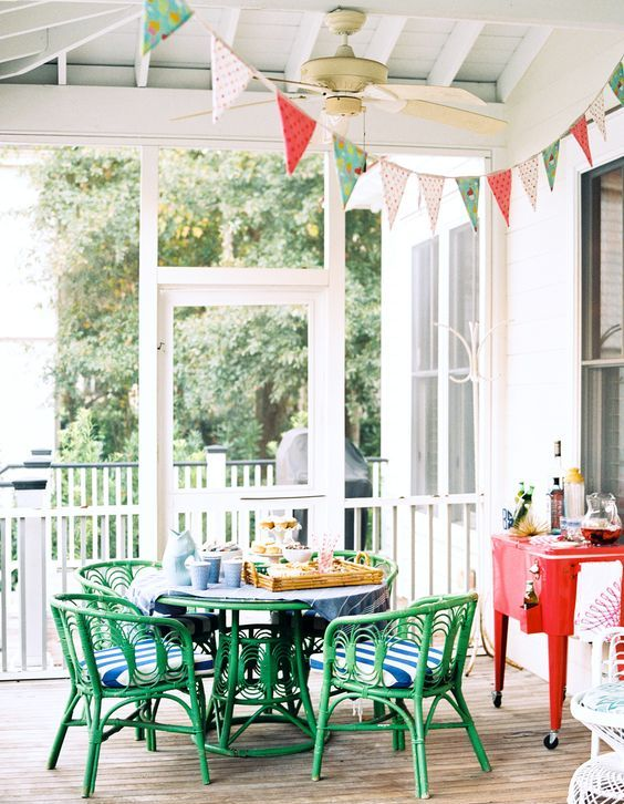 a bright green dining wicker set with striped cushions and a coral drink station
