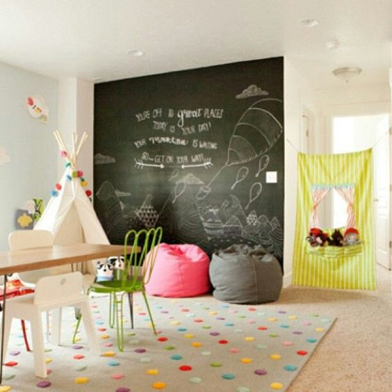 a colorful kids' playroom with a couple of bean bag chairs - a grey and a coral one for fun