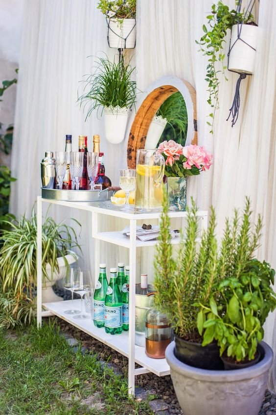 a glam outdoor bar made of an IKEA Micke desk is a genius idea and the piece looks very elegant