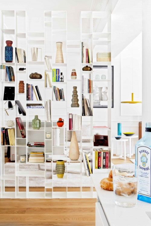 a large white shelving unit looks lightweight and can accommodate a lot of things you may need