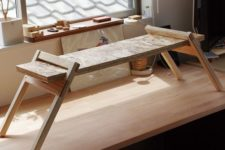 06 a small adjustable wooden desk can be placed on a usual one and removed when not in need