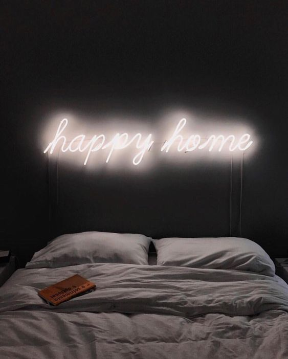 illuminate your bed with a neon light sig instead of a headboard to make it more welcoming