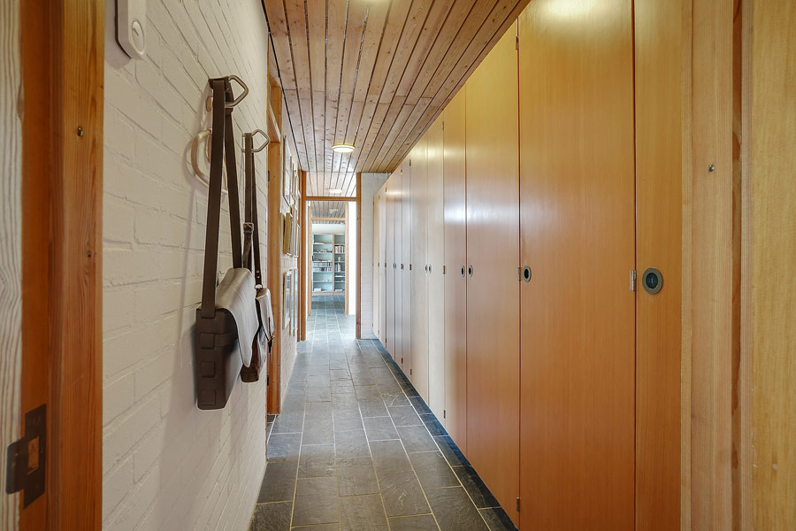 The corridor is also lined with similar wardrobes that are used for storage