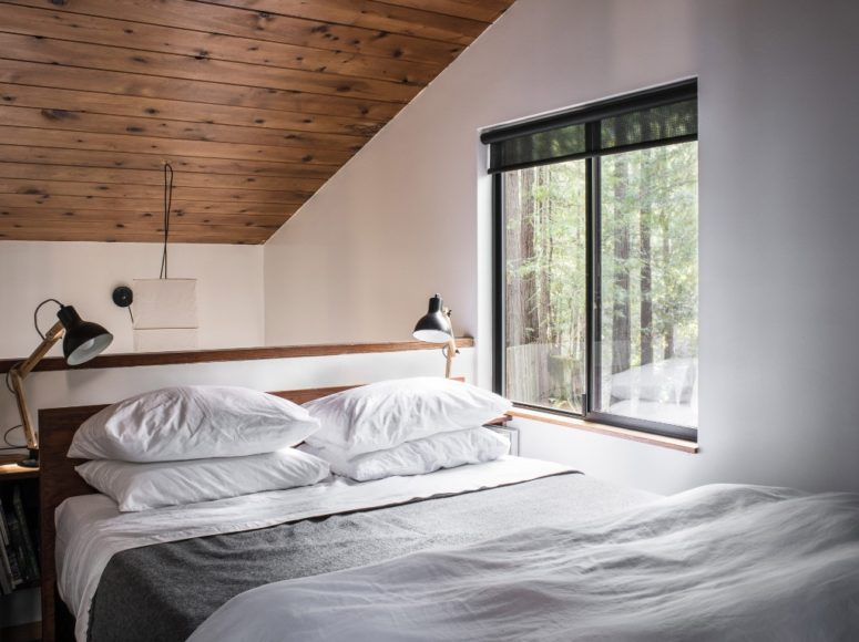 The master bedroom is an attic space with a view, there's a large bed and lots of wood