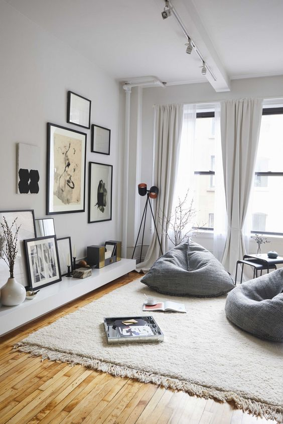 a couple of grey bean bag chairs is used instead of usual chairs to create a comfy nook