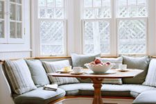 07 a cozy built-in chalf circle banquette seating with a small rustic table look very inviting