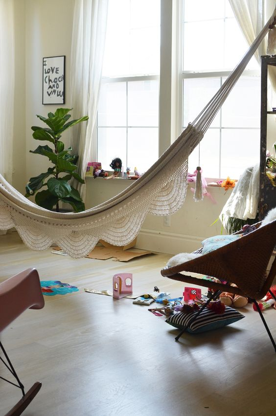 a kid's play space with a beautiful hammock for relaxing - such a solution doesn't take any floor space