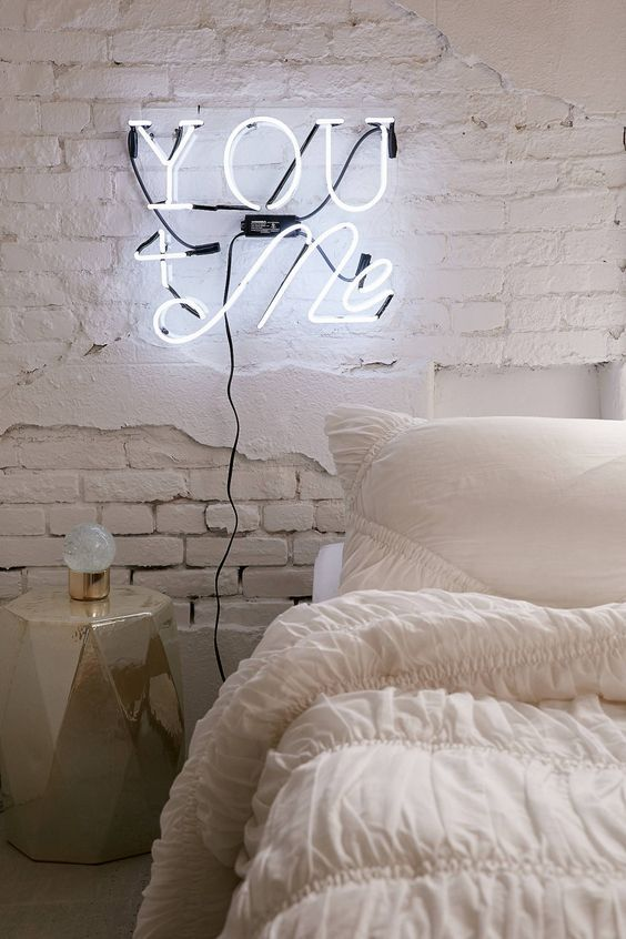 highlighting your bedroom with a neon light is easy - use it instead of a usual sconce and your space will get that magic