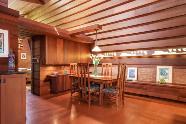 The dining space features some cabinets of redwood and a small dining set