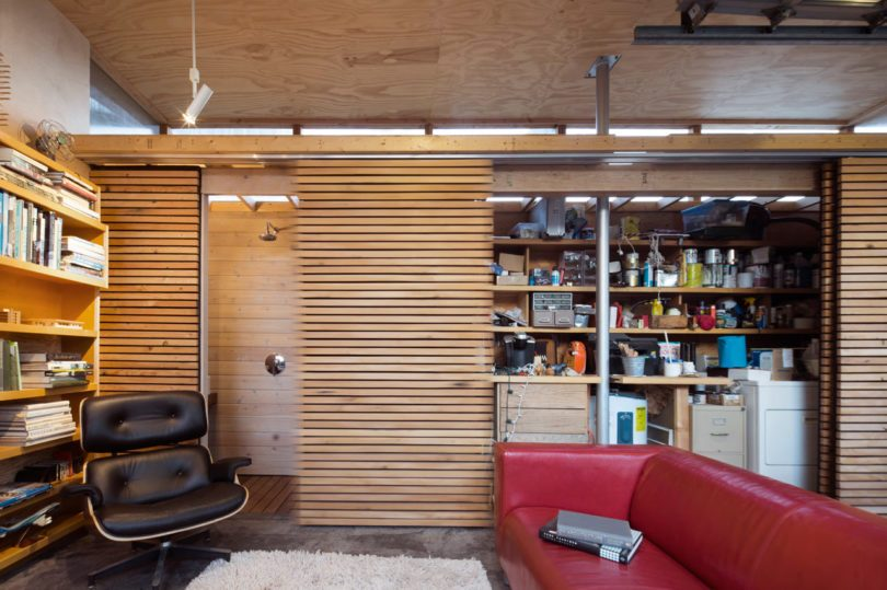 The storage is hidden behind the sliding doors of wooden planks