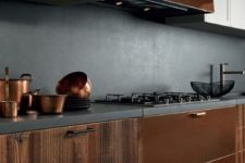08 a luxurious kitchen of wood and copper with a concrete backsplash and countertops