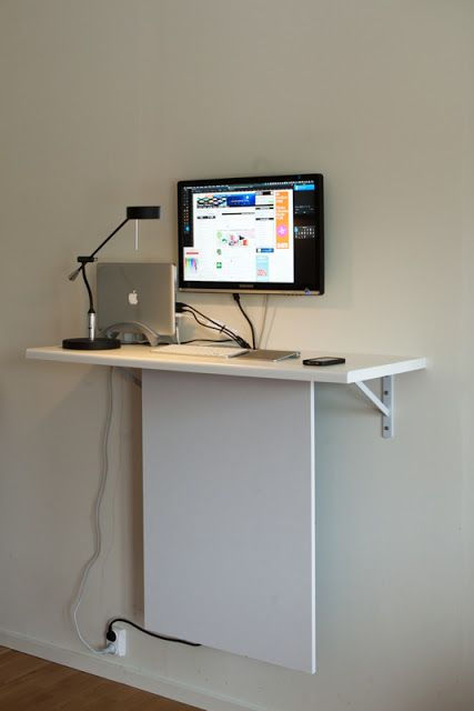 a tiny wall-mounted desk with hidden cables can accommodate a laptop or a wall-mounted screen