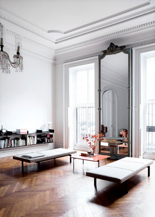 living space with a large mirror
