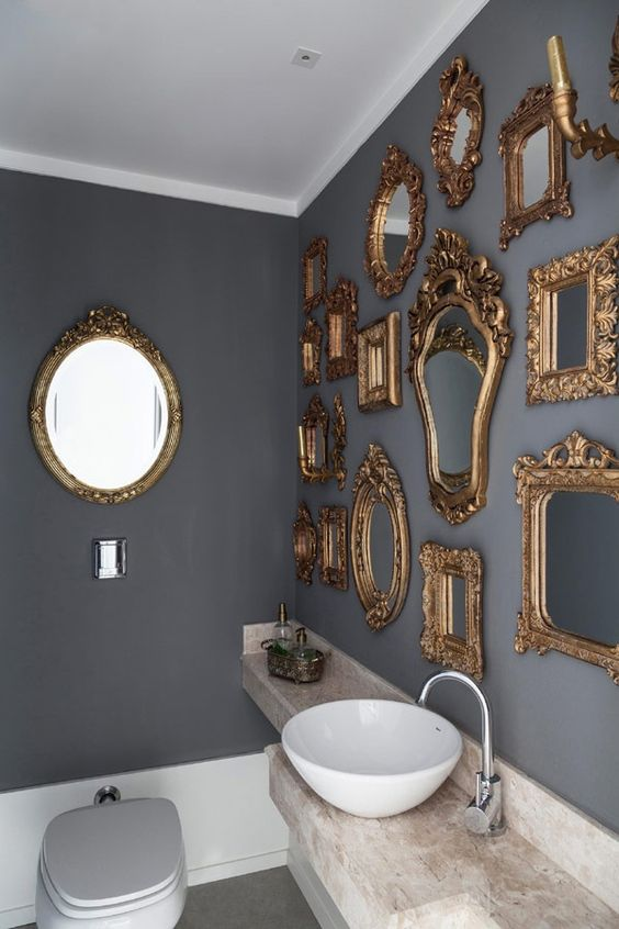 make your bathroom super refined and elegant hanging various gold antique frames on the wall