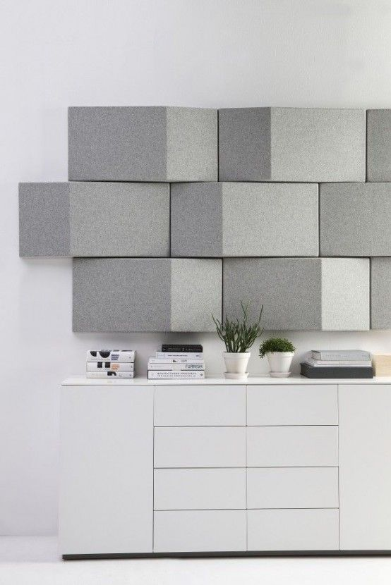 soundproof your space with geometric felt panels on the wall that will add a catchy touch at the same time