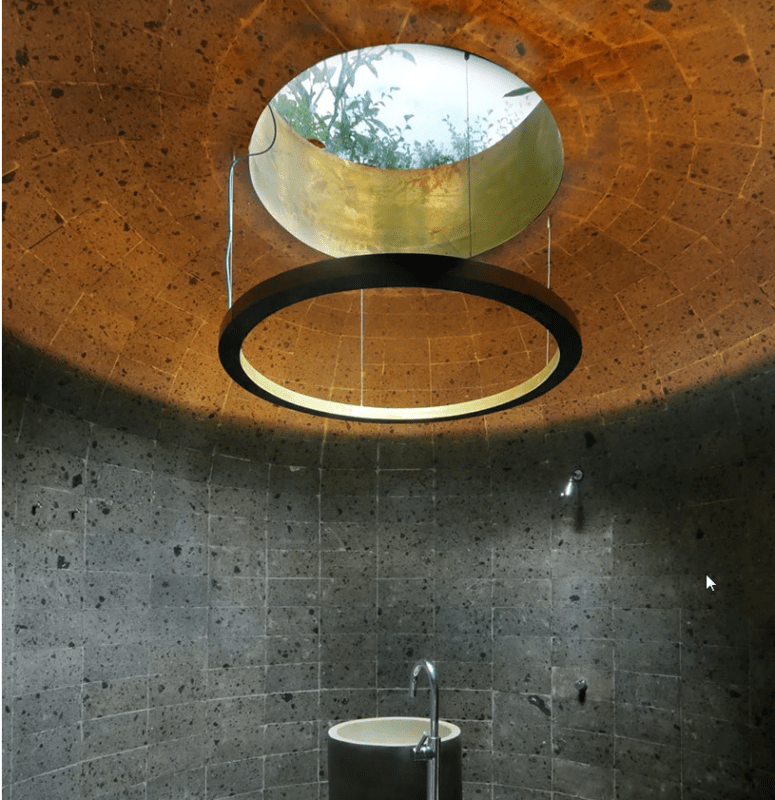 A powder room features a unique ceiling with a hanging structure to highlight it