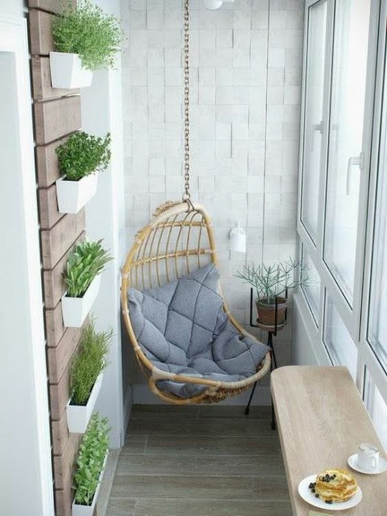 a hanging chair, wall-mounted planters, a folding table for having meals