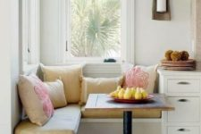 09 a little breakfast nook with a built-in corner banquette seating and a tiny table