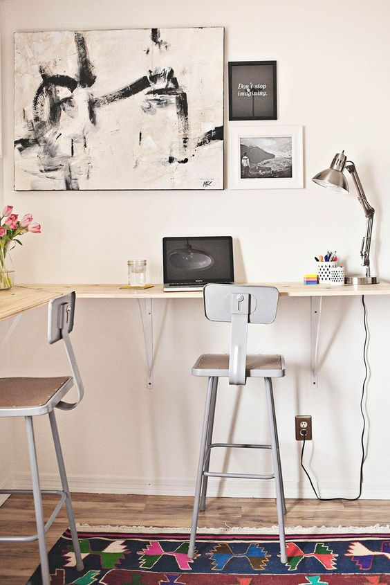 a simple wall-mounted double desk with tall stools is a nice idea that looks lightweight