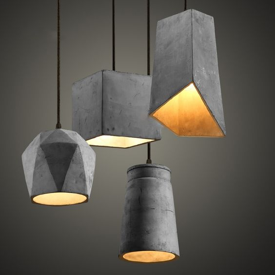 an arrangement of sculptural concrete pendant lamps that make a bold statement
