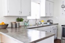 09 white kitchen with concrete countertops that add color and a texture to the space