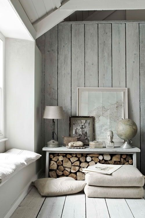 whitewashed greyish wood planks bring a coastal feel to the space and look very natural