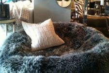 10 a faux sheep skin bean bag chair with a pillow cna be used both as a chair or as a lounger