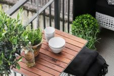 10 a hanging table, metal chairs and a wicker seat plus potted greenery for a lively modern look
